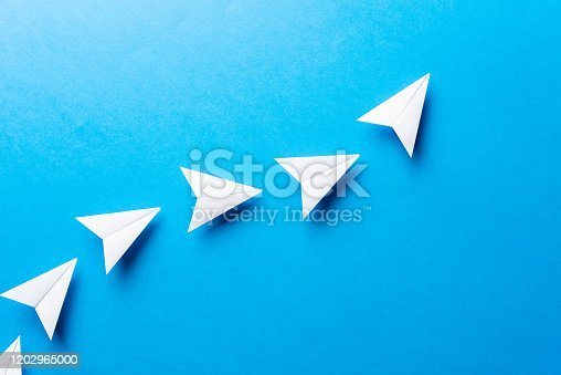 istock Progress concept. Agile development attainment, motivation, growth concept. Business concept of goals, success, achievement and challenge. White paper airplanes on blue background. 1202965000