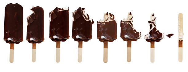 Progression of Ice Cream Bars Being Eaten Progression of chocolate covered vanilla ice cream bars on a wooden stick with bites taken out. Isolated over a white background. ice cream bar stock pictures, royalty-free photos & images