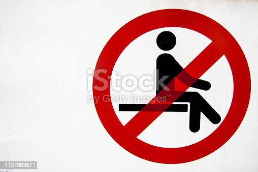 istock Prohibition sign to sit down with white background 1137063671
