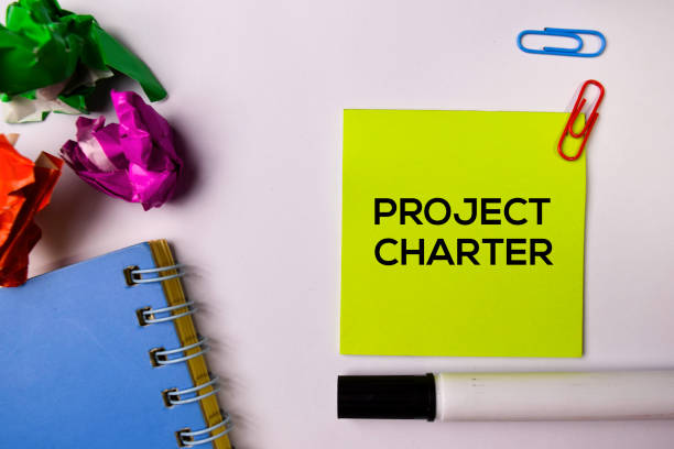 Project Charter on sticky notes isolated on white background. Project Charter on sticky notes isolated on white background. public housing stock pictures, royalty-free photos & images