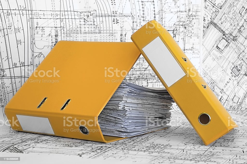 Project drawings and yellow folders royalty-free stock photo
