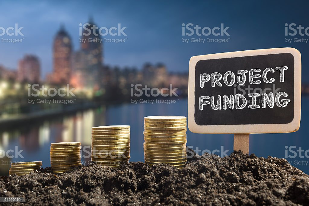 Project funding. Financial opportunity, business and intertnet concept. Golden coins stock photo