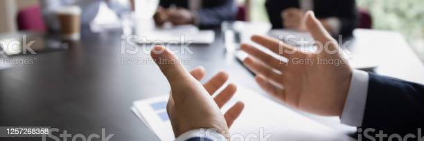 Project leader gesticulate hands while talking during meeting close picture id1257268358?b=1&k=6&m=1257268358&s=612x612&h=twai86ohcapgxr5oo6joo7h0kneerlsvcjyvfrsl2g0=