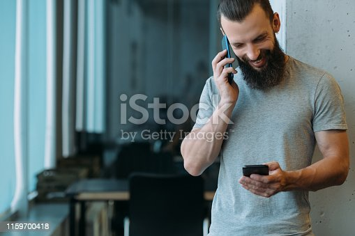 1161068403 istock photo project management man smartphones talk office 1159700418