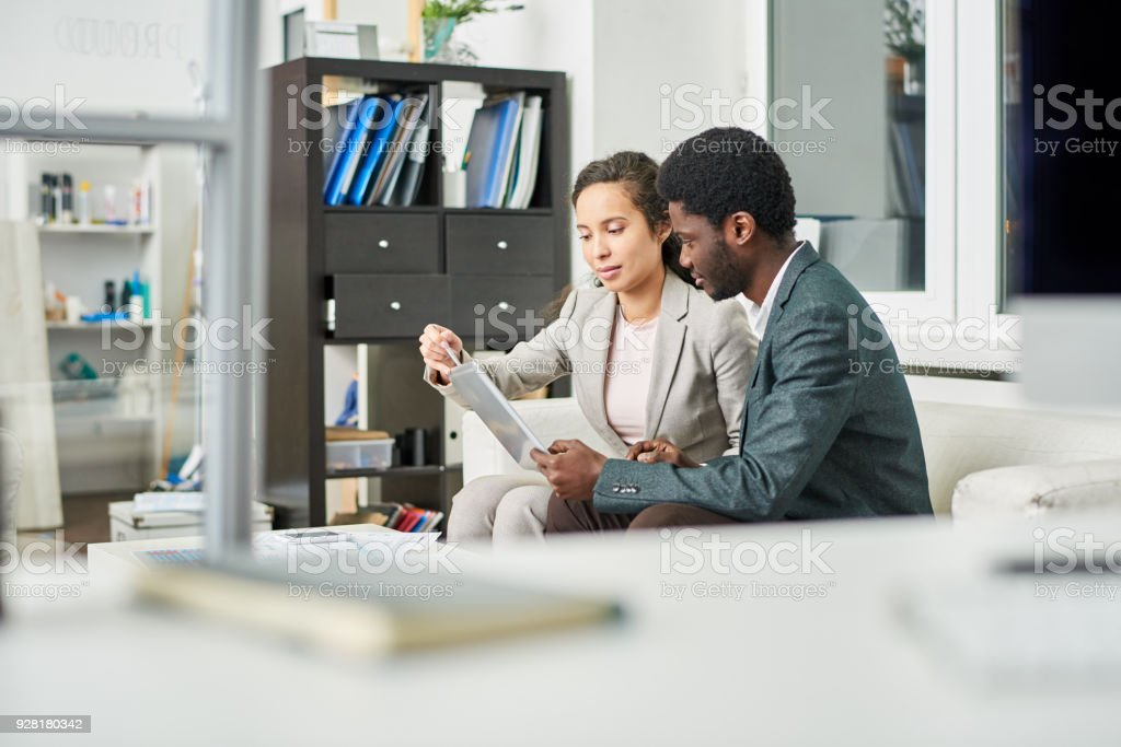 Project manager explaining budget plan to customer stock photo