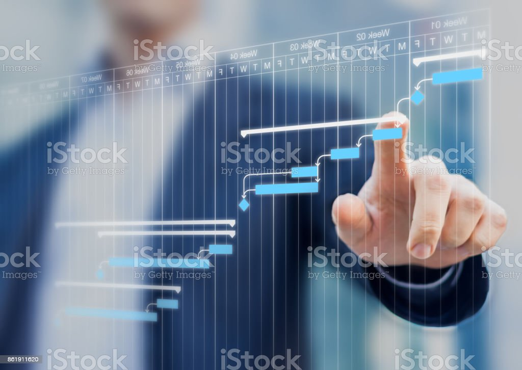 Project manager updating Gantt chart planning on a virtual screen stock photo