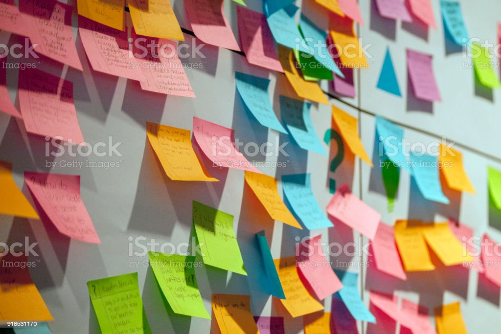 Project Planning Gathering all the stakeholders to generate ideas and create business plans Adhesive Note Stock Photo