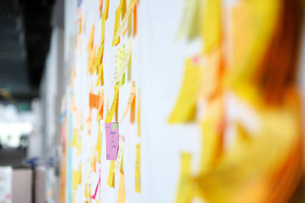 Project Planning, Sticky Notes Wall full of multi colored adhesive, sticky notes, project planning. agility stock pictures, royalty-free photos & images