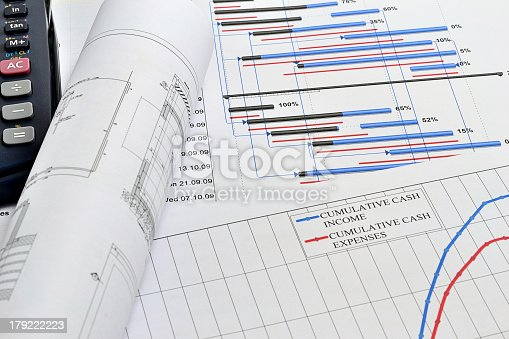 614338352 istock photo Project planning with blueprints and plans 179222223