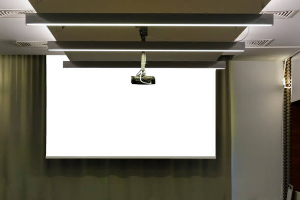 Projector in a room with projector screen on back ground. Projector in a room with projector screen on back ground overhead projector stock pictures, royalty-free photos & images