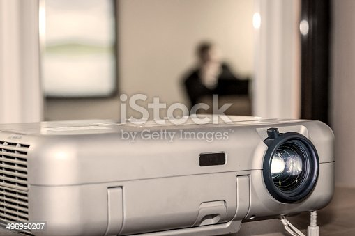 istock Projector on office table 496990207