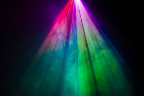 projector spotlight rainbow color on smoke texture . beautiful rainbow color wide lens projector with light beam for movie and cinema at night . smoke texture spotlight . screening for multimedia . black background . illuminated stock pictures, royalty-free photos & images