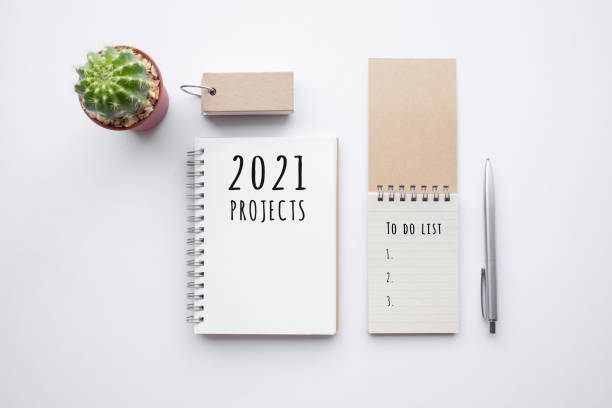 2021 projects or plan concepts with text on notepad and office accessories. stock photo