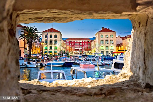 Prokurative square in Split evening view through stone window, Dalmatia, Croatia