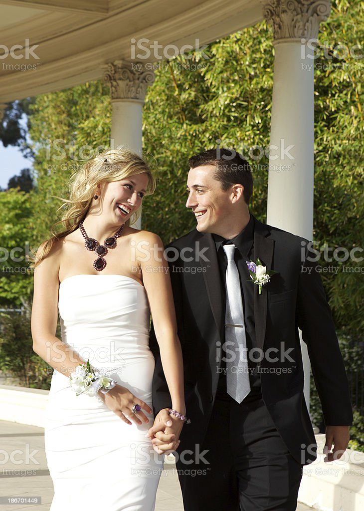 Prom Couple Walking and Smiling at Each Other royalty-free stock photo