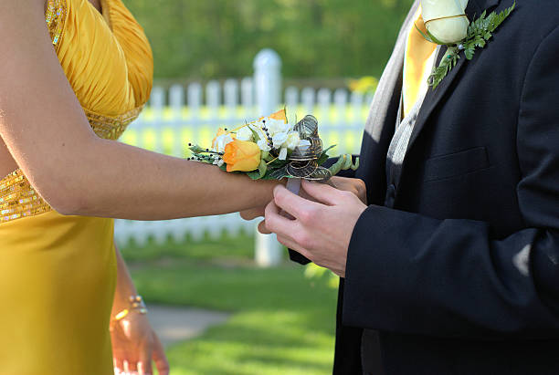 prom wedding couple corsage - prom stock photos and pictures