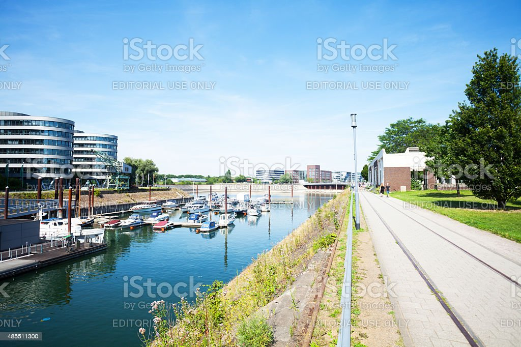 Promenade and yachts in inner harbor Duisburg stock photo