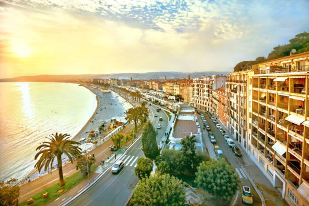 日落時尼斯的海濱長廊。蔚藍海岸, 法國 - 法國 個照片及圖片檔