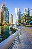 Dubai, UAE - December 5. 2019 - People go for a walk in an ultra modern city - Dubai Marina.