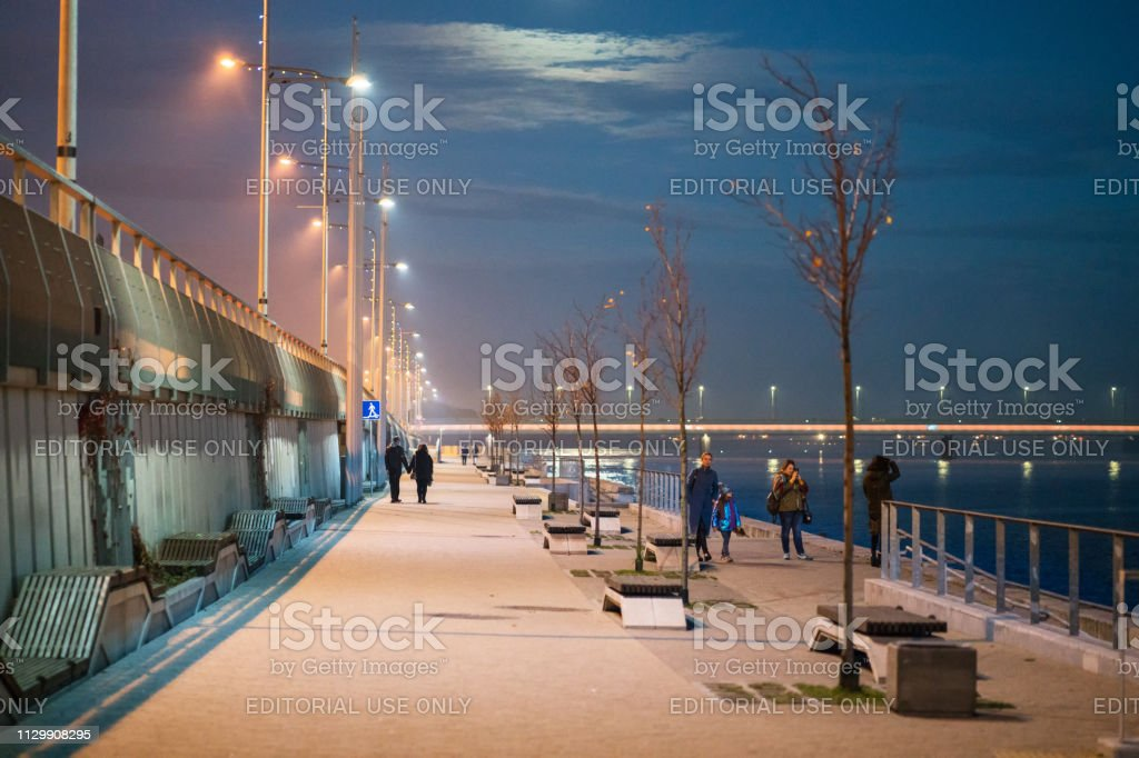 Promenade of the river Daugava on an autumn evening stock photo
