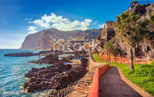 The beautifil Promenade walk from Funchal Lido into the fishing viallge of Camara de Lobos on Madeira at sunset