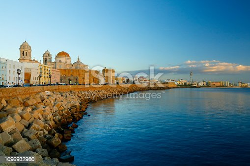 Promenade with the protection wall and the New Cathedral at Cadiz, Andaluse, Spain