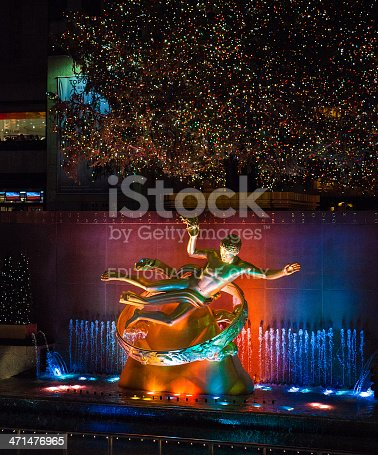 New York, United States - January 3, 2009: Golden Prometheus Statue at the Rockefeller Center in New York, fully illuminated at night and still with the holiday motives during the first days of year 2009.