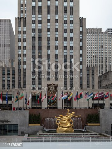 New York City - February 27, 2019: Prometheus Statue at Rockefeller Center in New York City in the winter with the ice skating rink.