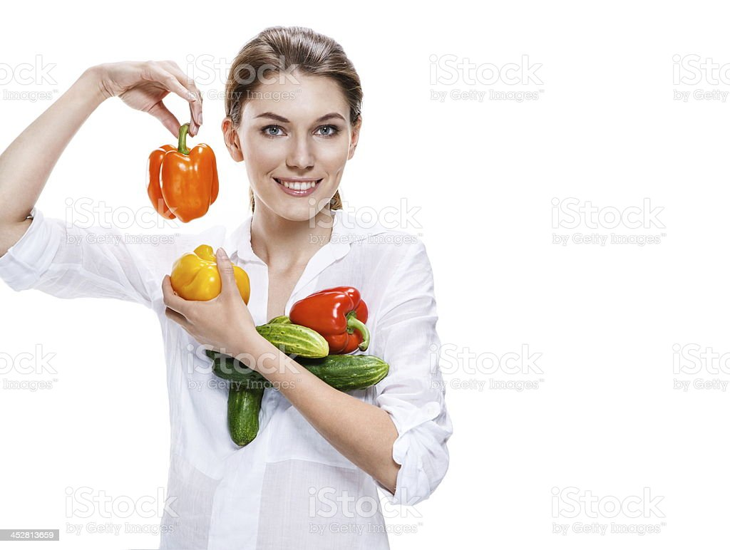 promo girl holding a paprika and cucumbers - isolated stock photo