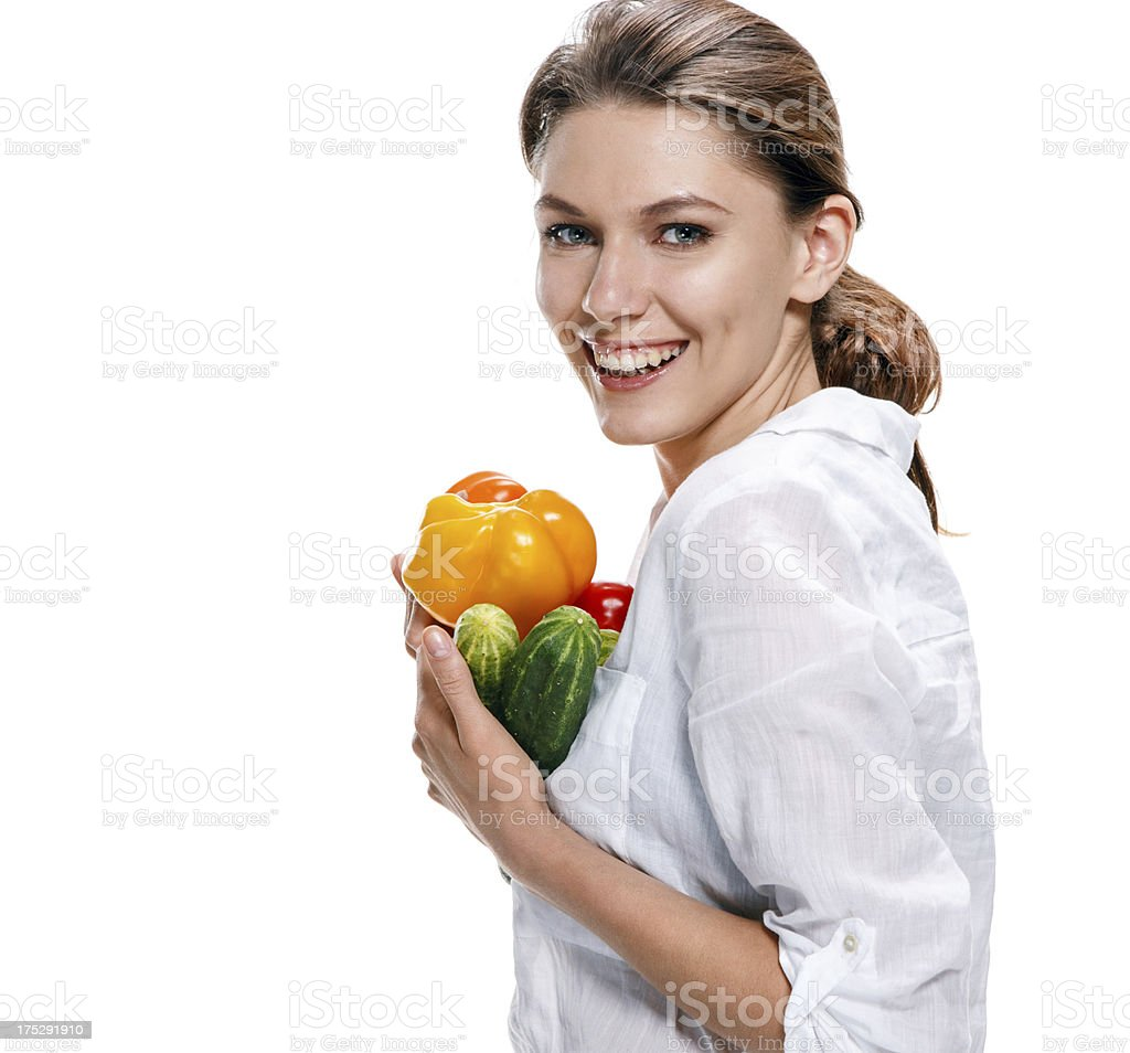 promo girl holds yellow paprika and green cucumbers - isolated royalty-free stock photo