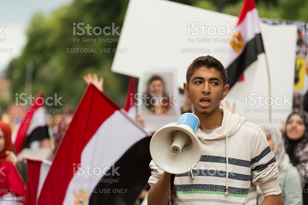 pro-Morsi young supporter with the megaphone stock photo