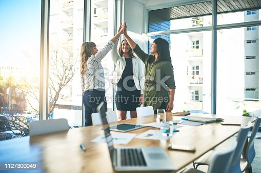 1031394114istockphoto Promoting and celebrating a work environment where women are empowered 1127300049