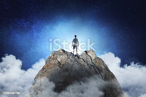 Businessman standing on abstract mountain on sky background. Promotion and leadership concept
