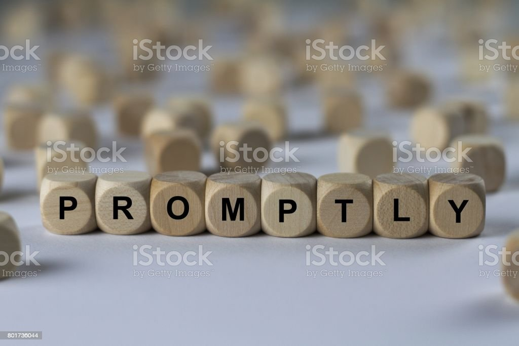 promptly - cube with letters, sign with wooden cubes stock photo