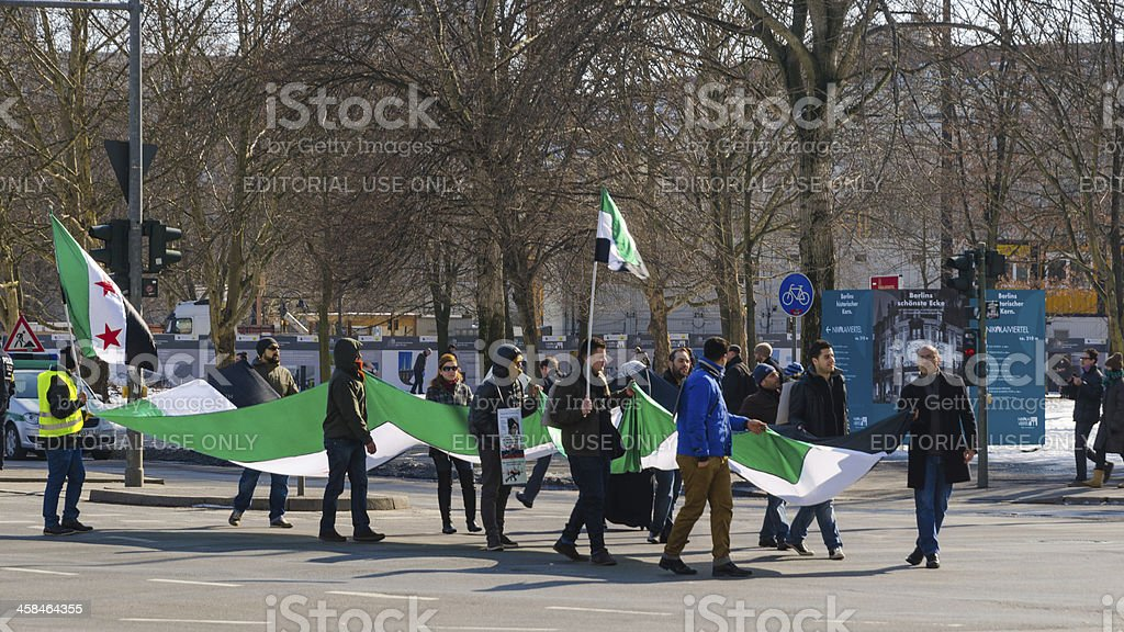 Pro-opposition activists carrying the Syrian flag on demonstrati royalty-free stock photo