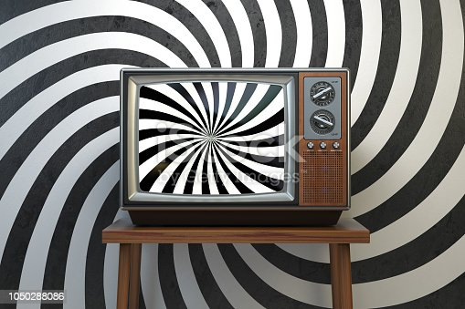 istock Propaganda and brainwashing of the influential mass media concept. Vintage TV set with hypnotic spiral on the screen. 1050288086