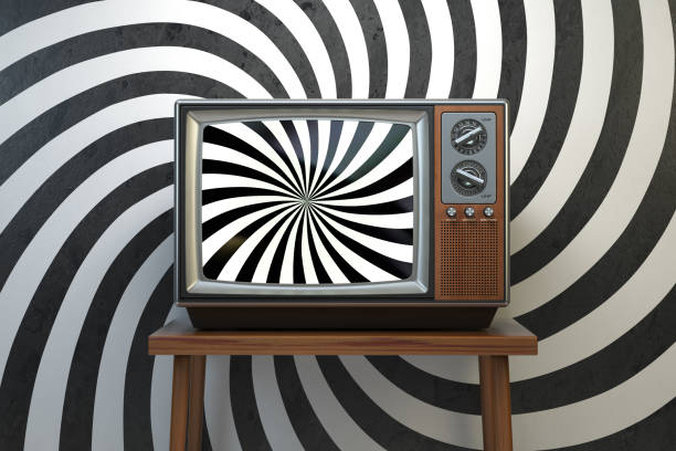 Propaganda and brainwashing of the influential mass media concept. Vintage TV set with hypnotic spiral on the screen. stock photo