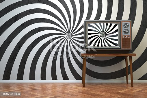 istock Propaganda and brainwashing of the influential mass media concept. Vintage TV set withhypnotic spiral on the screen. 1057231394