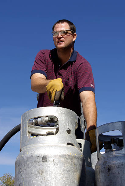 propane man - mikefahl stock pictures, royalty-free photos & images