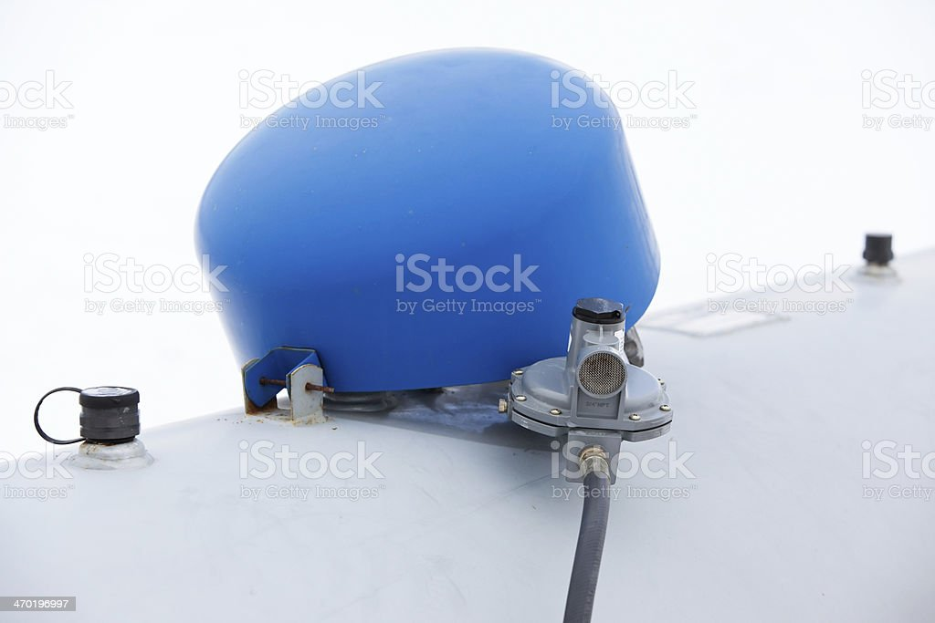 Propane Tank Cover and Valve Against Snow stock photo