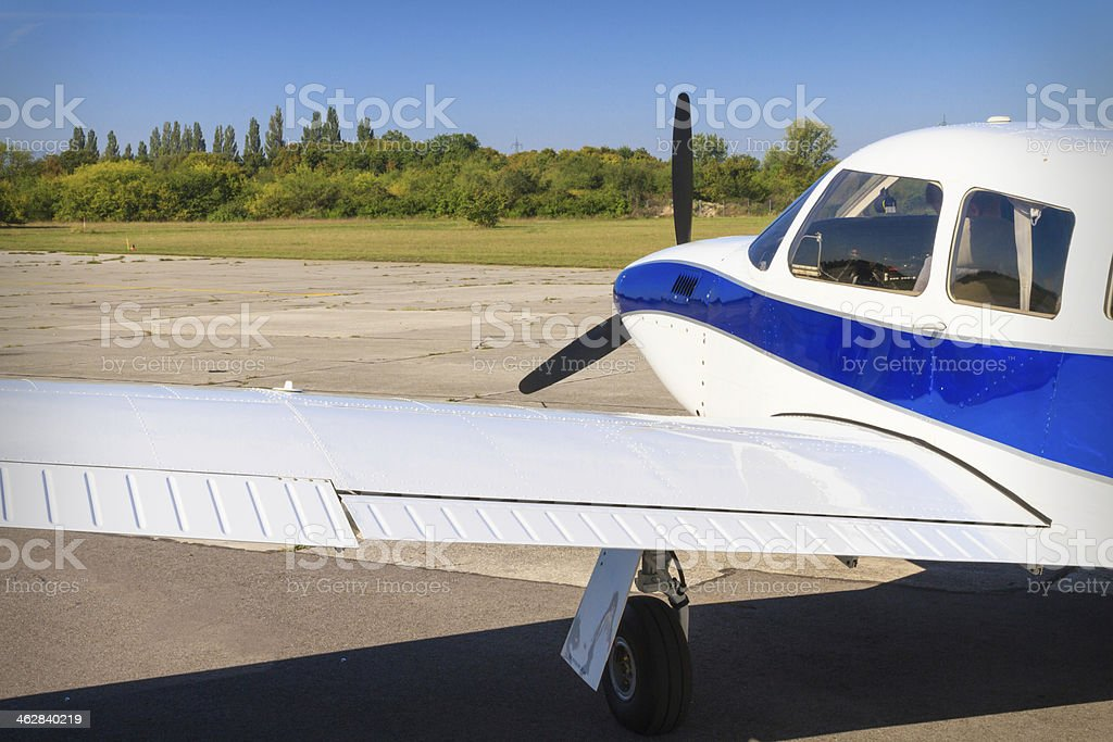 Propeller air plane on runway stock photo