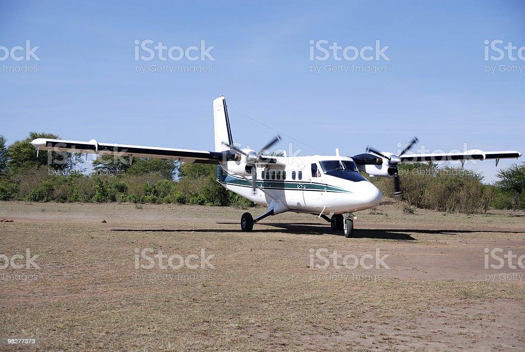Propeller aircraft landed on a bush airstrip royalty-free stock photo