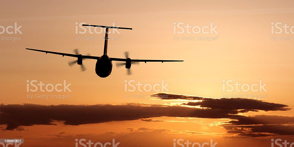 propeller airplane flying at dusk royalty-free stock photo