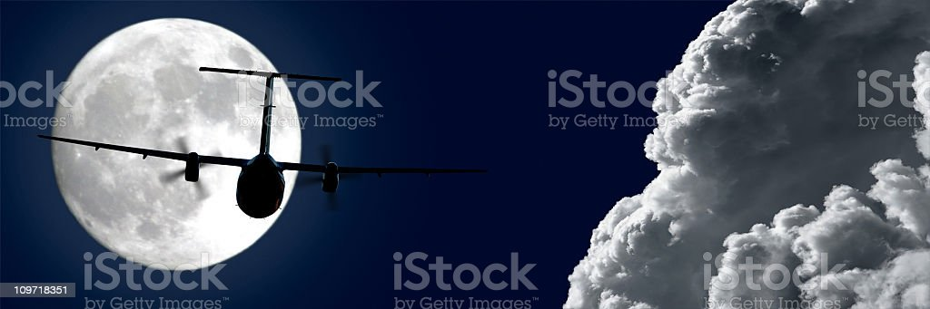 propeller airplane flying at night stock photo