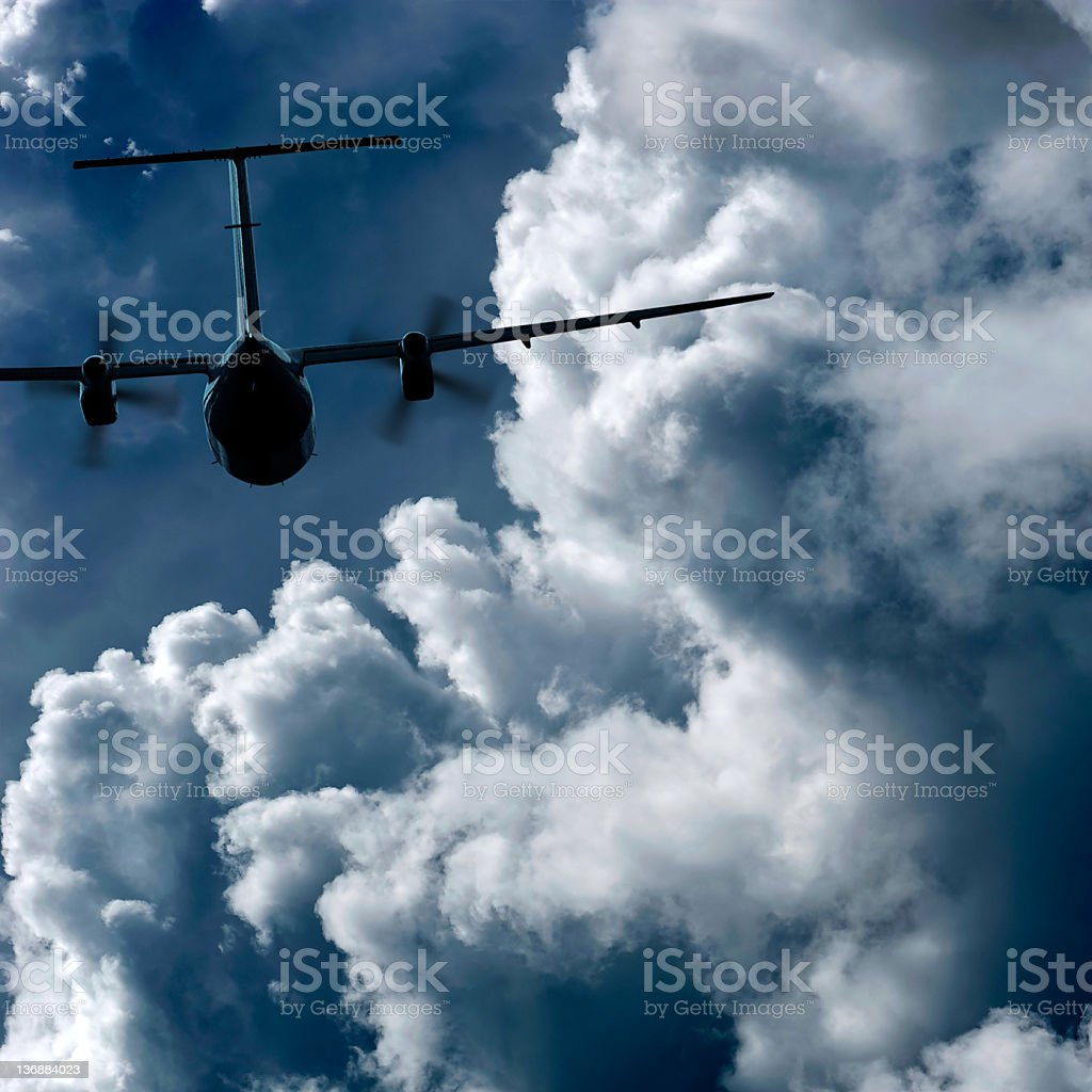 propeller airplane flying in storm royalty-free stock photo