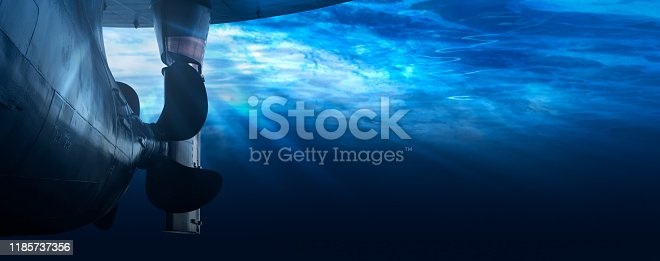 istock Propeller and rudder of big ship underway from underwater. Close up image detail of ship. Transportation industry. Freight transportation. 1185737356