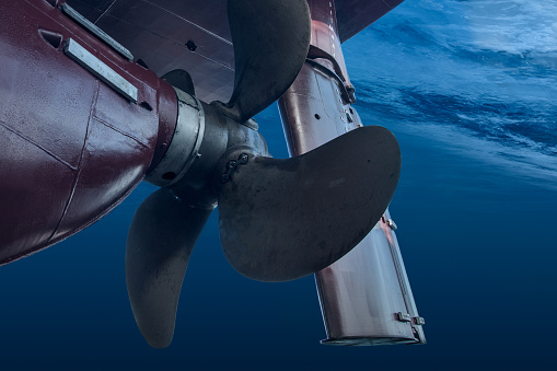 propeller and rudder of big ship underway view from underwater close picture