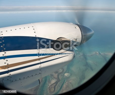 Prop on a 16 seat twin engine jet flying over Bahamas