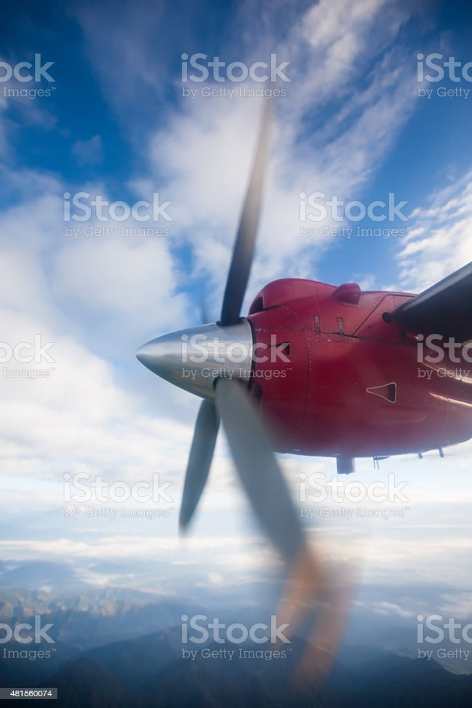 Propeller plane in air above Himalayas stock photo