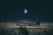 istock Propeller-driven airliner In The Desert At Night 1312641383